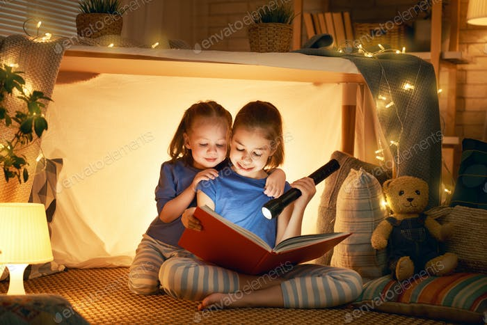 children are reading a book