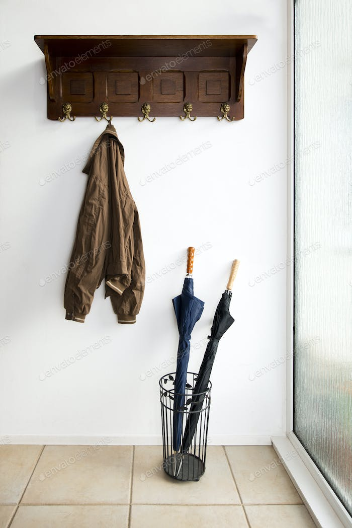 54185,Jacket and umbrellas in foyer of home
