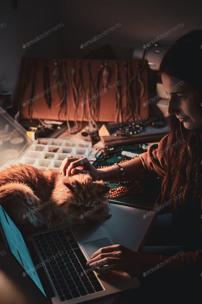 Busy girl and her fluffy cat