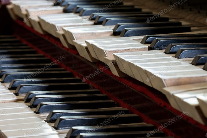 Abstract detail of old, broken and dusty organ keys