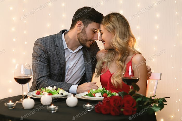 Loving Young Couple Bonding On Romantic Date In Restaurant
