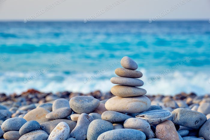 Zen balanced stones stack on beach