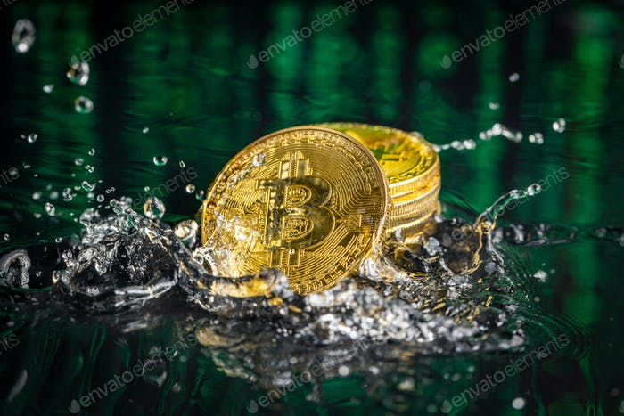 Gold bitcoin coin falling to water. Bitcoin and water splash.
