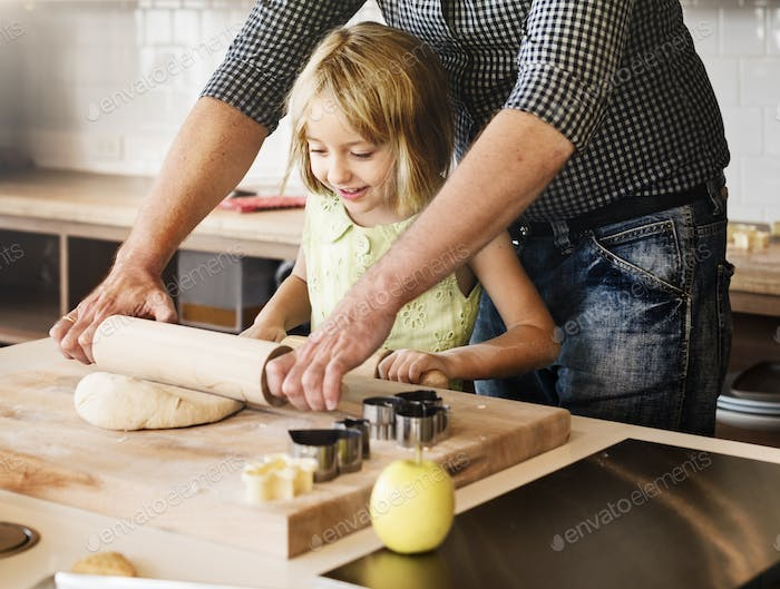 Father Daughter Helping Cookng Bakery Concept