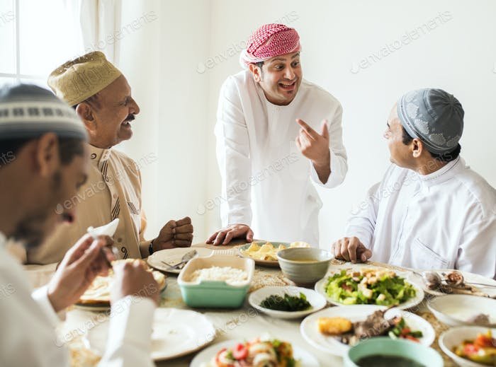 Muslim men celebrating ending of Ramadan