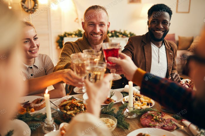 Adult People Raising Glasses at Dinner Party