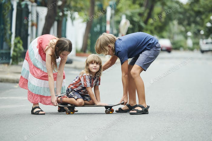 Kids Playing with Younger Brother