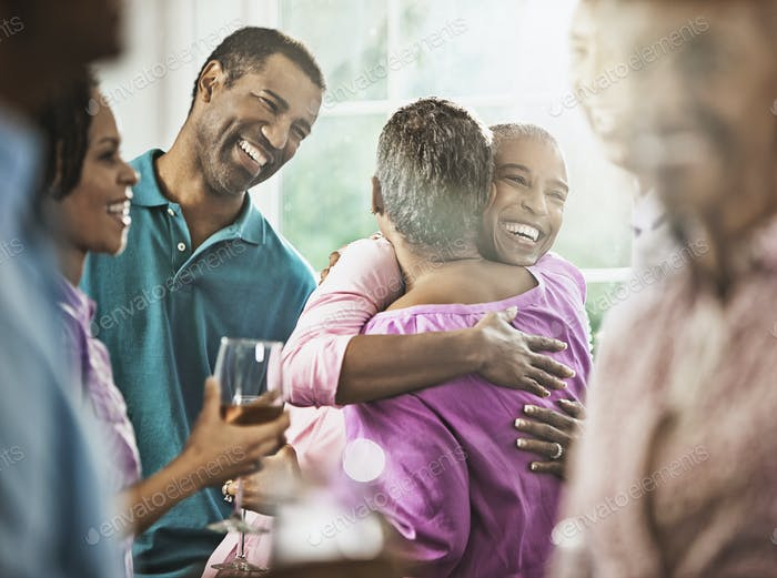 A group of African Americans of similar age, baby boomer generation at a party