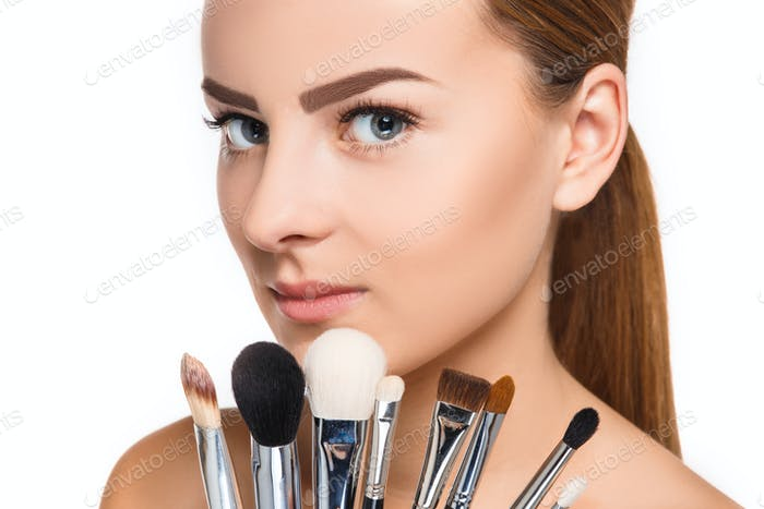 Beautiful female eyes with make-up and brushes