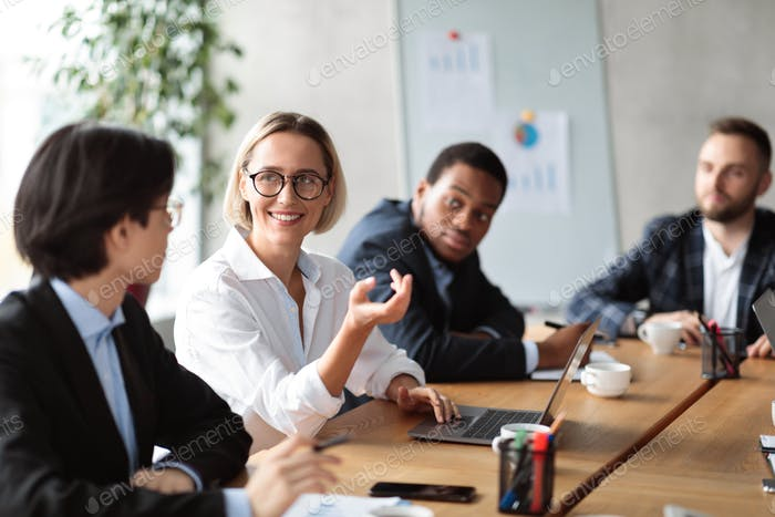 Diverse Business People Having Corporate Meeting In Modern Office