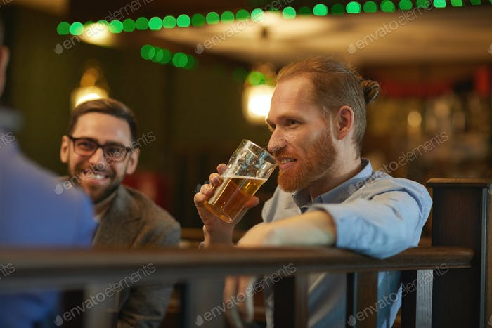 Man drinking beer with friends