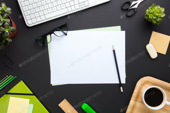 Blank Documents Surrounded By Office Supplies On Gray Desk