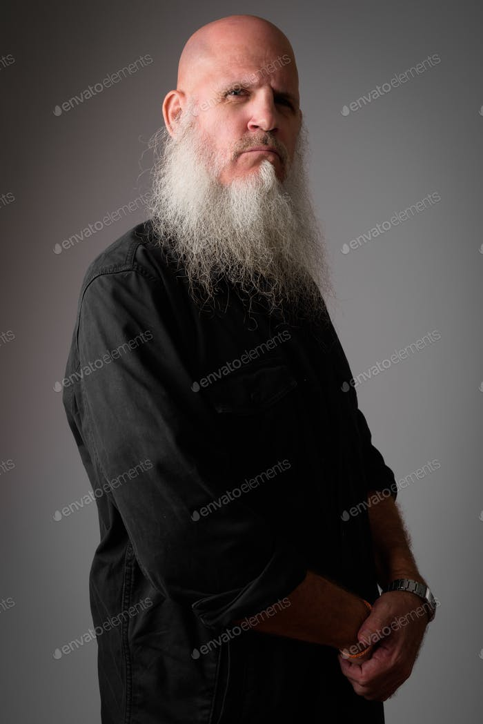 Profile view of mature bald man with long beard