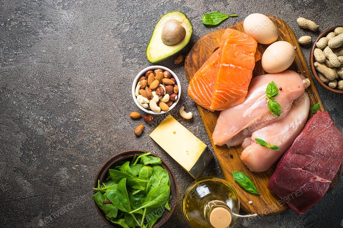 Ketogenic low carbs diet on dark stone table