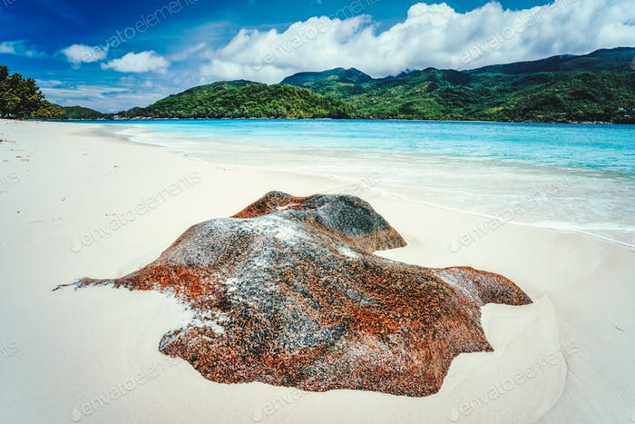 Tropical lagoon with granite boulders in the turquoise water and a pristine white sand Seychelles