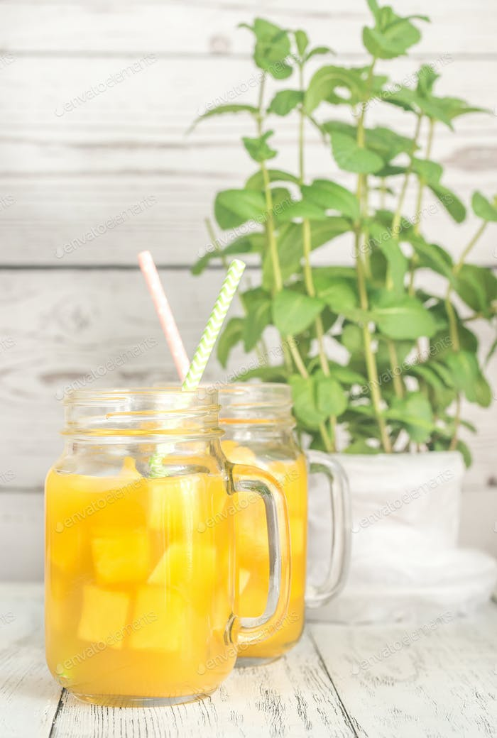 Mango juice in mason jar