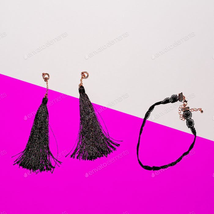 Set of stylish jewelry. Earrings and Choker. Top view