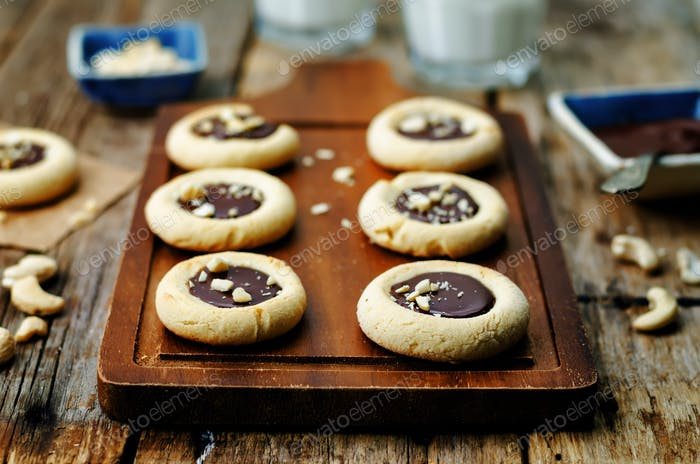 cashews butter cookies with cashews and chocolate frosting