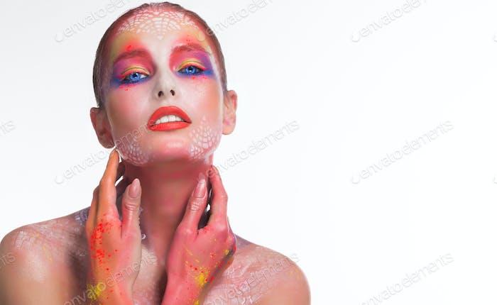 Beautiful woman with bright creative art makeup