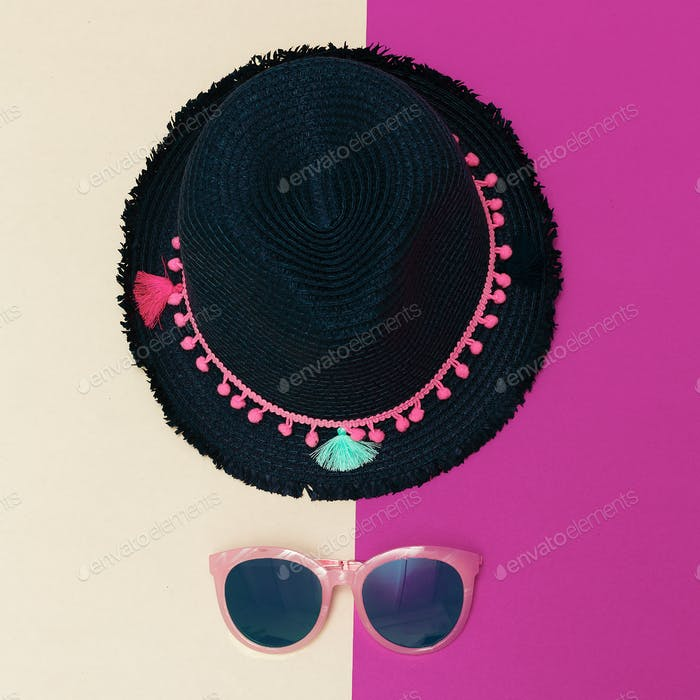 Summer hat and sunglasses. Minimal accessory trend