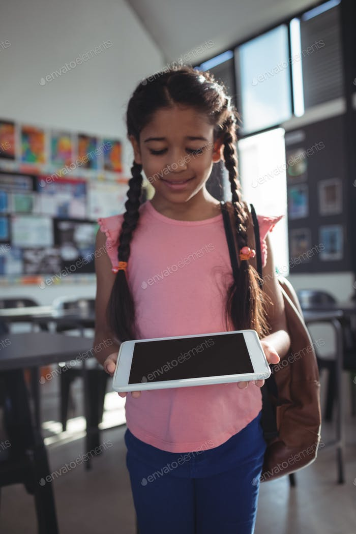 Smiling girl using tablet computer