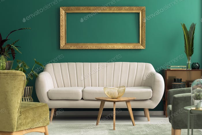 Bright sofa in green interior