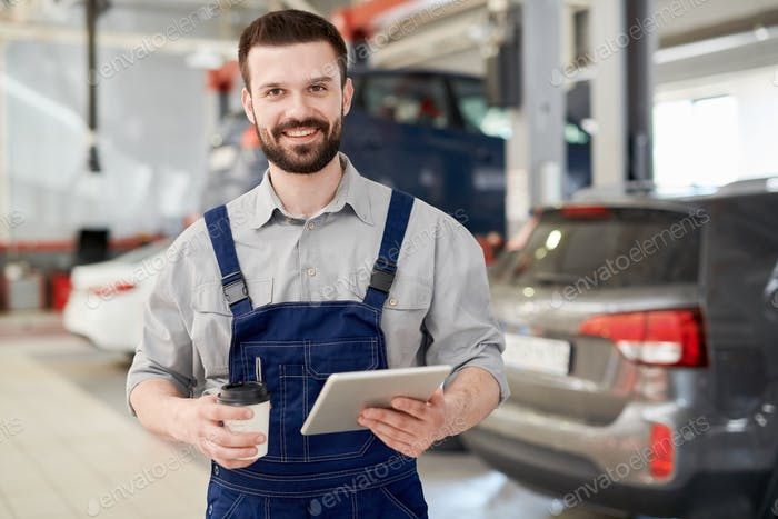 Smiling Worker in Car Service