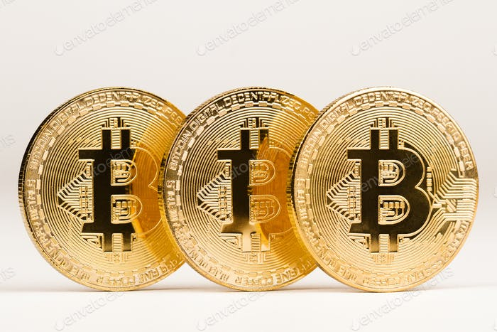 closeup of golden bitcoin metallic coins