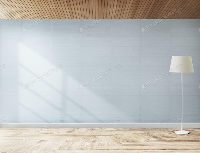 Lampe gegen eine blaue Wand Mockup