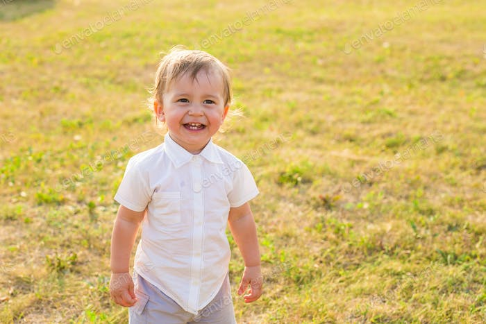 Portrait of cute little boy outdoor in summer