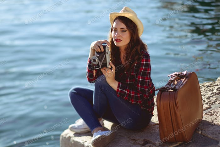 Woman taking photographs with a vintage camera
