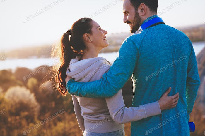 Happy young sporty couple sharing romantic moments