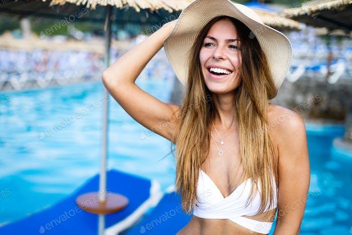 Beautiful sexy woman in bikini on beach during vacation