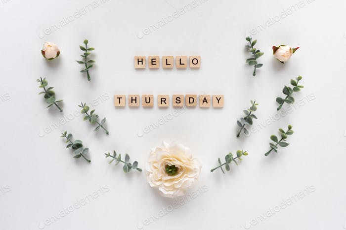 Hello Thursday words on white marble background