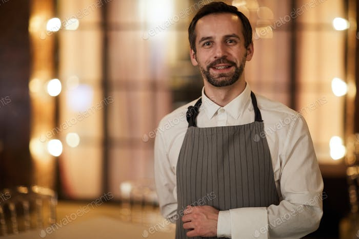 Mature Waiter in Restaurant