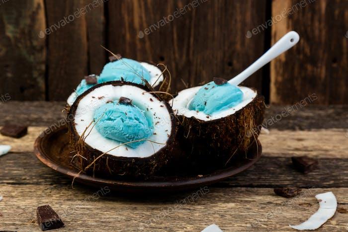 Blue ice cream in coconut bowl.