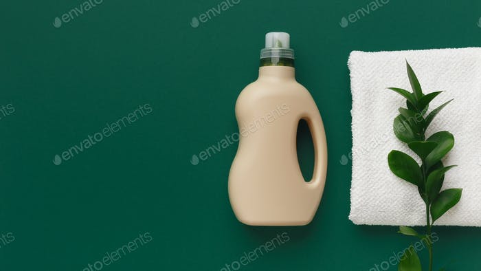 Bottle with washing conditioner and towel with natural smell