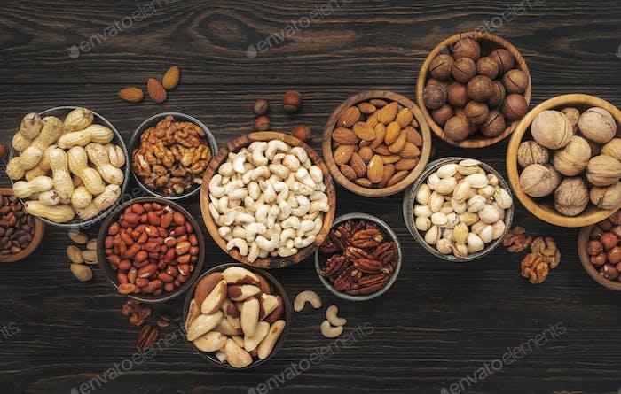 Assortment of nuts in bowls. Cashews, hazelnuts, walnuts, pistachios