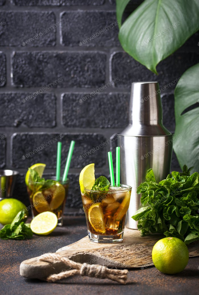 Cuba libre cocktail with mint and lime