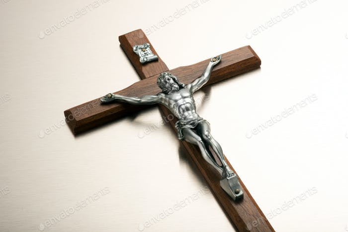 Silver metal Christ on a wooden crucifix