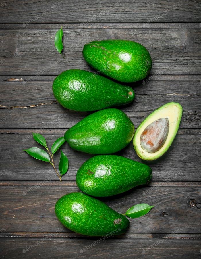 Ripe avocado and one half avocado.