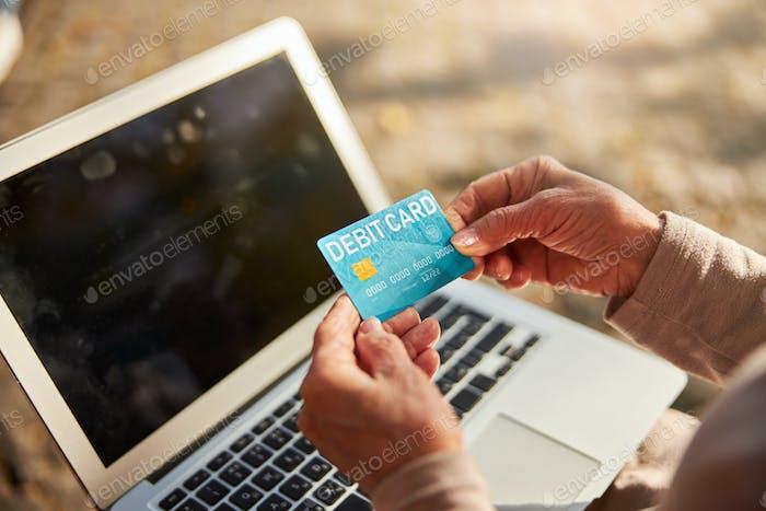 Debit card in the hands of a pensioner