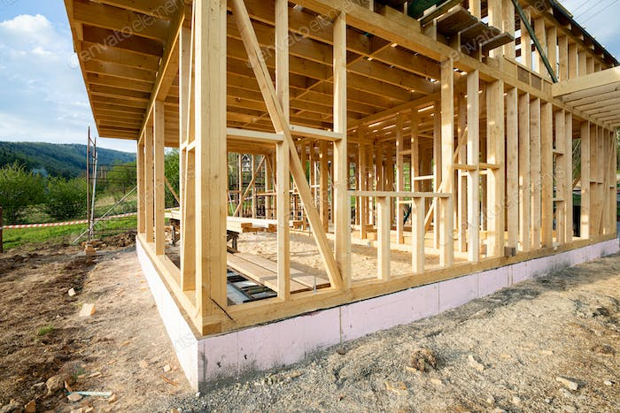 New wooden frame house under construction, outdoor residential home