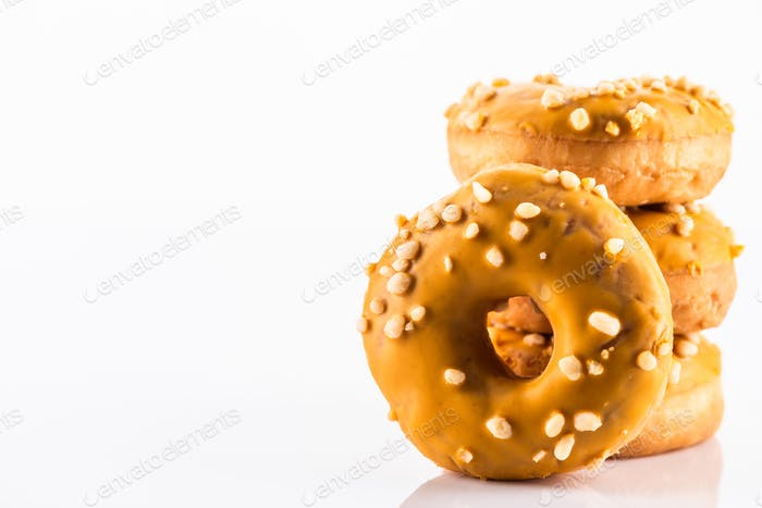 Salted Caramel Donut or Doughnuts on White Reflective Background with Copy Space