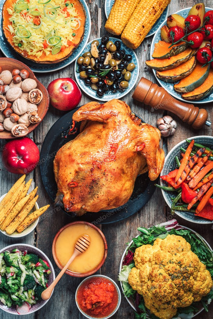 Christmas or Thanksgiving whole roasted chicken, rice, pumpkin, corn, honey, nuts, vegetable salads