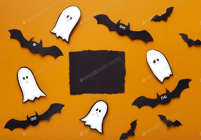 Terrifying Halloween flat lay on orange background with bats and ghosts