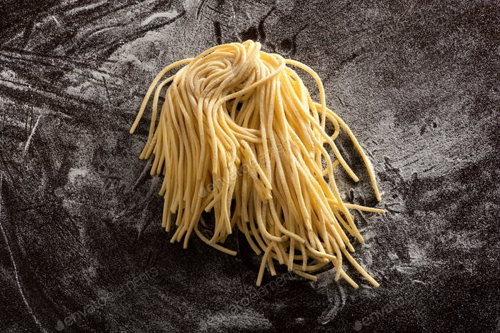 Bundle of uncooked homemade spaghetti