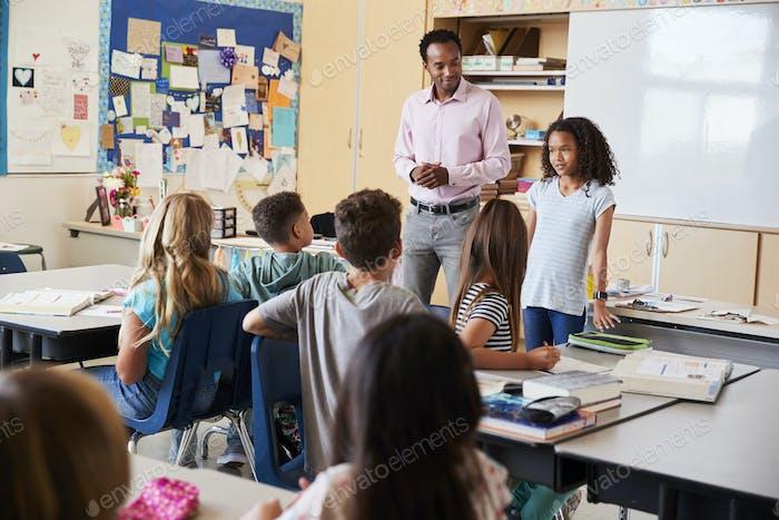 Schoolgirl presenting to her elementary school classmates
