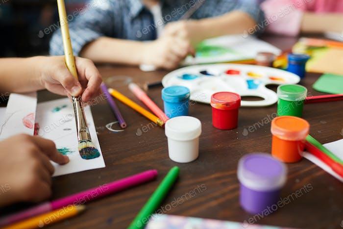 Closeup of Children Painting in Art Class