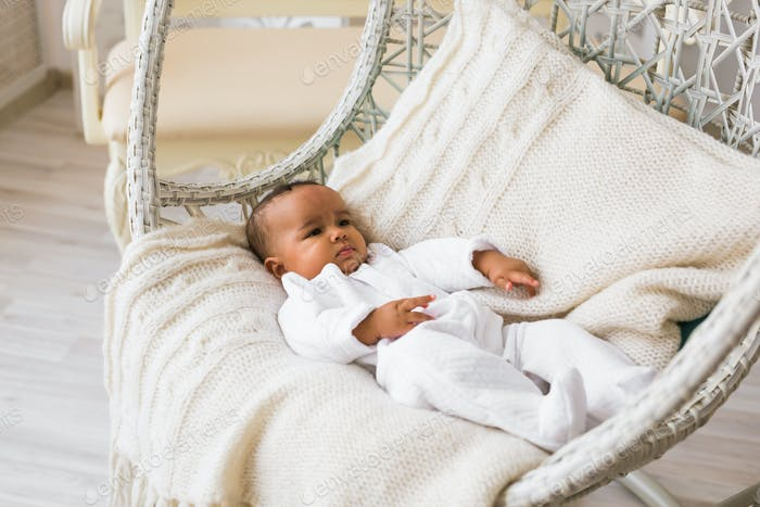 Adorable little african american baby boy looking - Black people